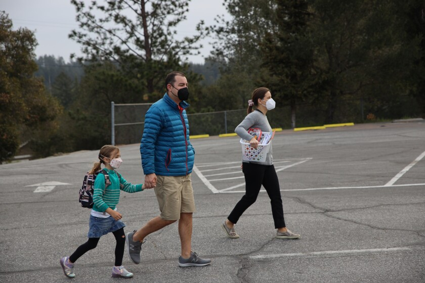 A family walks their kindergartener to class at Brook Knoll Elementary School.