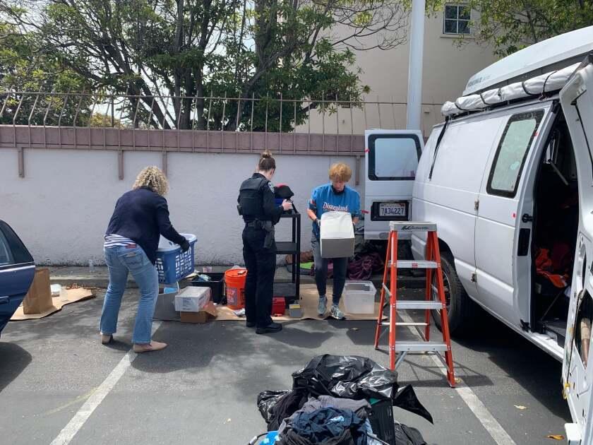 Santa Cruz police return stolen property to Holy Cross School on Friday.