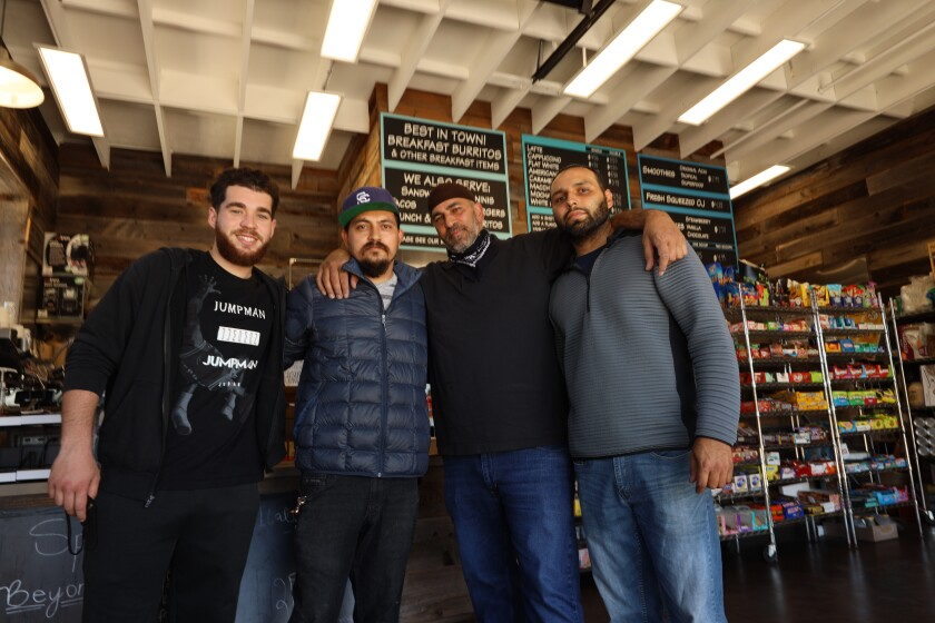 Owner Hassan Ayyad and his crew at Pacific Point Market and Cafe in Santa Cruz