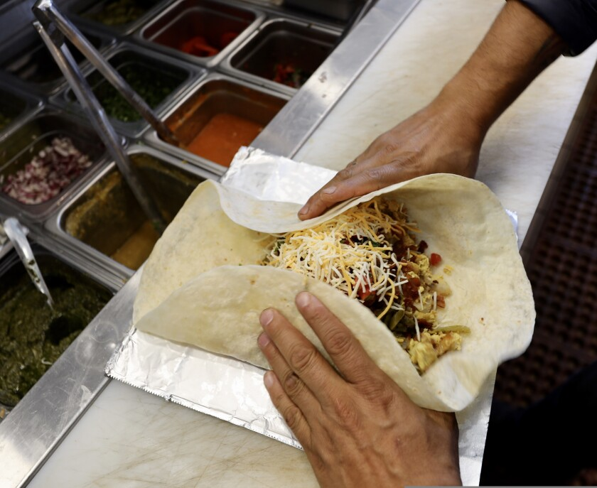A burrito takes shape at Pacific Point Market and Cafe