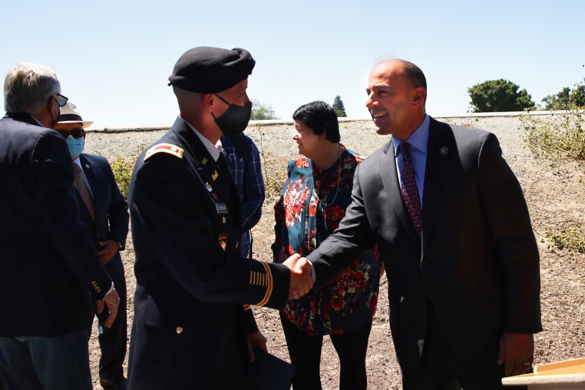 Rep. Jimmy Panetta shakes hands with Lt. Col. John Cunningham of the U.S. Army Corps of Engineers on Monday in Watsonville.