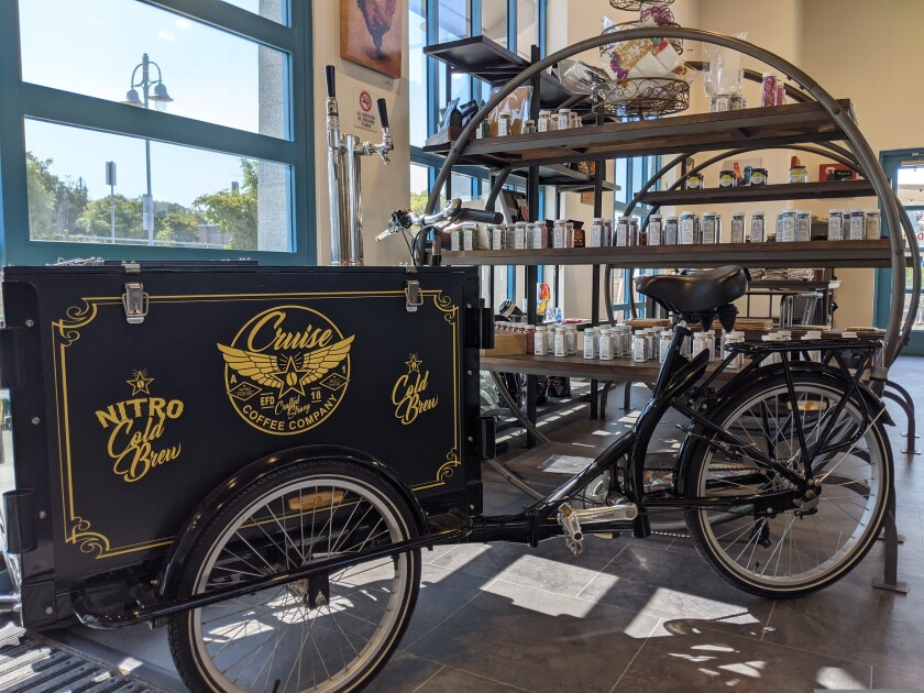 The Cruise Coffee Company bicycle and nitro coffee stand sits inside Cruise Coffee Cafe.