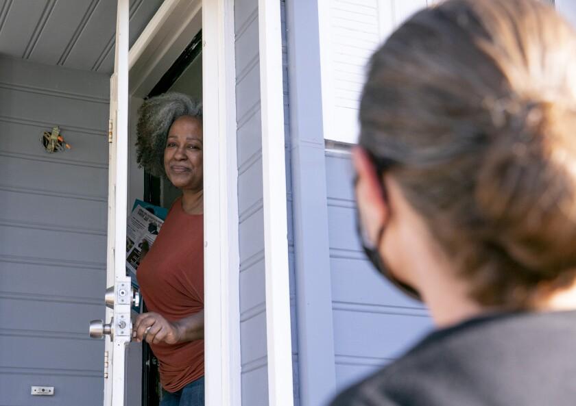 Oakland resident Leta Smith speaks with union volunteer Jennifer Shanoski about the Newsom recall.