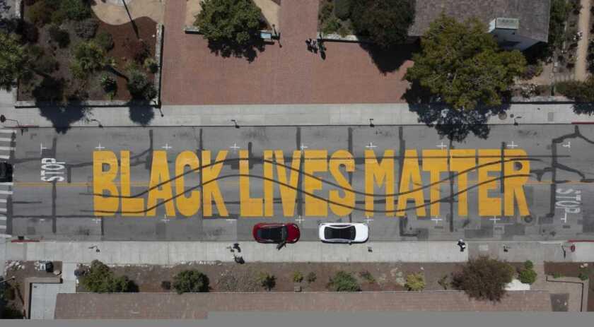 Aerial view of vandalized mural.