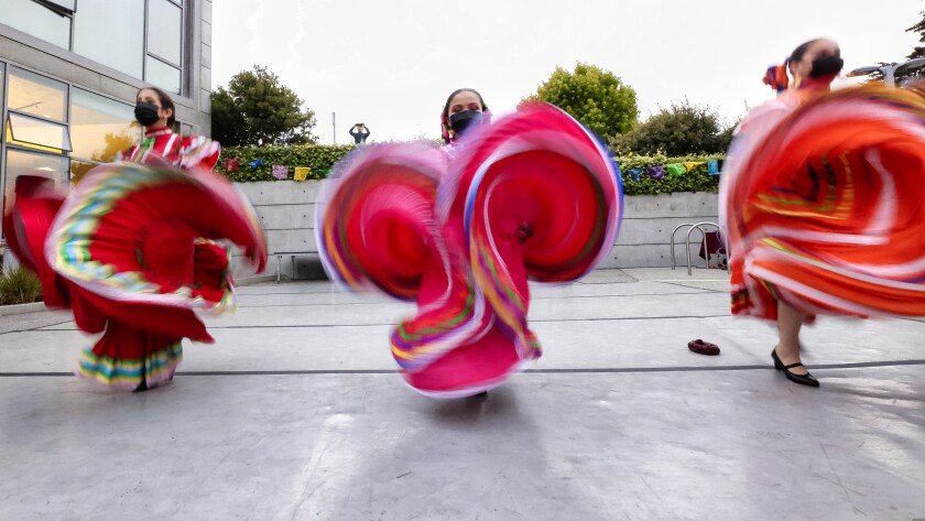 Dancers from Senderos perform Friday night.