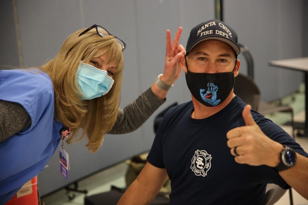 Matthew Haut from Santa Cruz Fire along with nurse Pamela Price pose before Matthew receives his injection.
