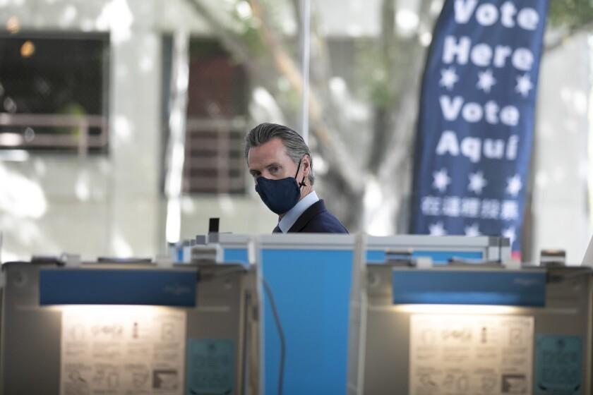 Gov. Gavin Newsom prepares to vote in the recall election at the Secretary of State building in Sacramento