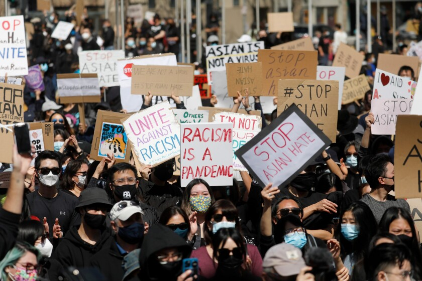 """Demonstrators attend the """"#StopAsianHate Community Rally"""" at San Jose City Hall Plaza in downtown San Jose"""
