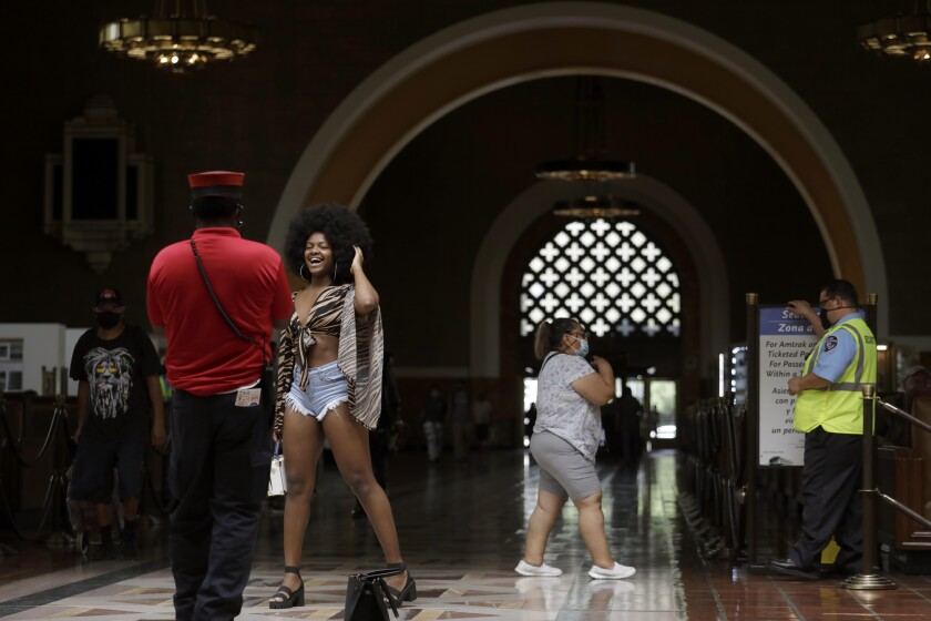 A woman has her picture taken in a train station