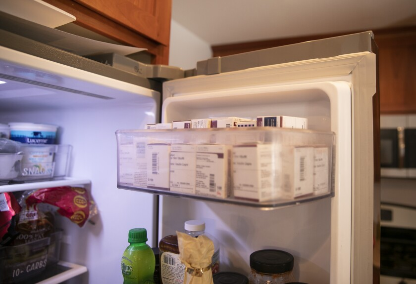 """A stash of insulin on the top shelf of the refrigerator at Tuominen's home in Livermore. """"We tend to stockpile,"""" she said. Photo by Anne Wernikoff, CalMatters"""