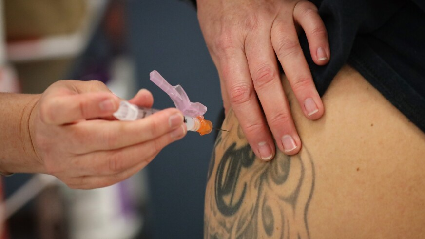 Firefighters get vaccinated at Watsonville Hospital on Tuesday.