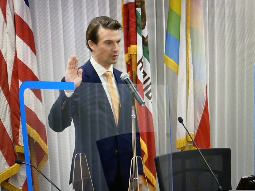 Santa Cruz County First District Supervisor Manu Koenig is sworn in during a ceremony at the supervisor chambers.