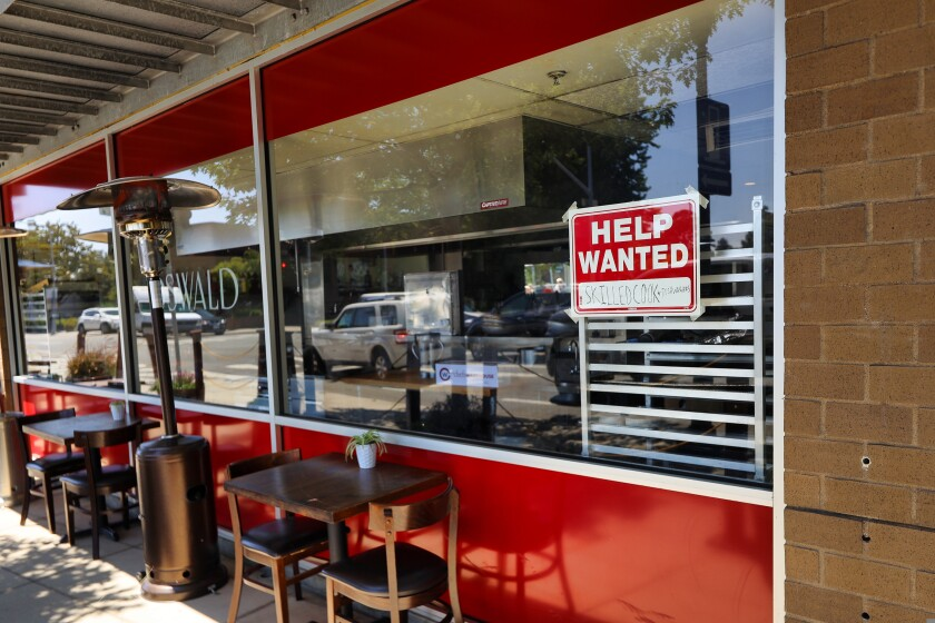 """A """"Help Wanted"""" sign hangs outside Oswald Restaurant in downtown Santa Cruz."""