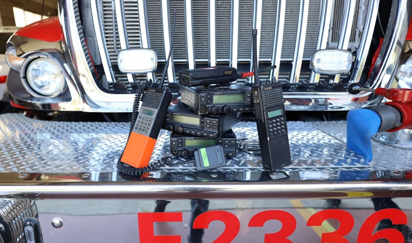 Old and outdated radios and receivers are stacked on the bumper of one of the Felton Fire Department trucks.