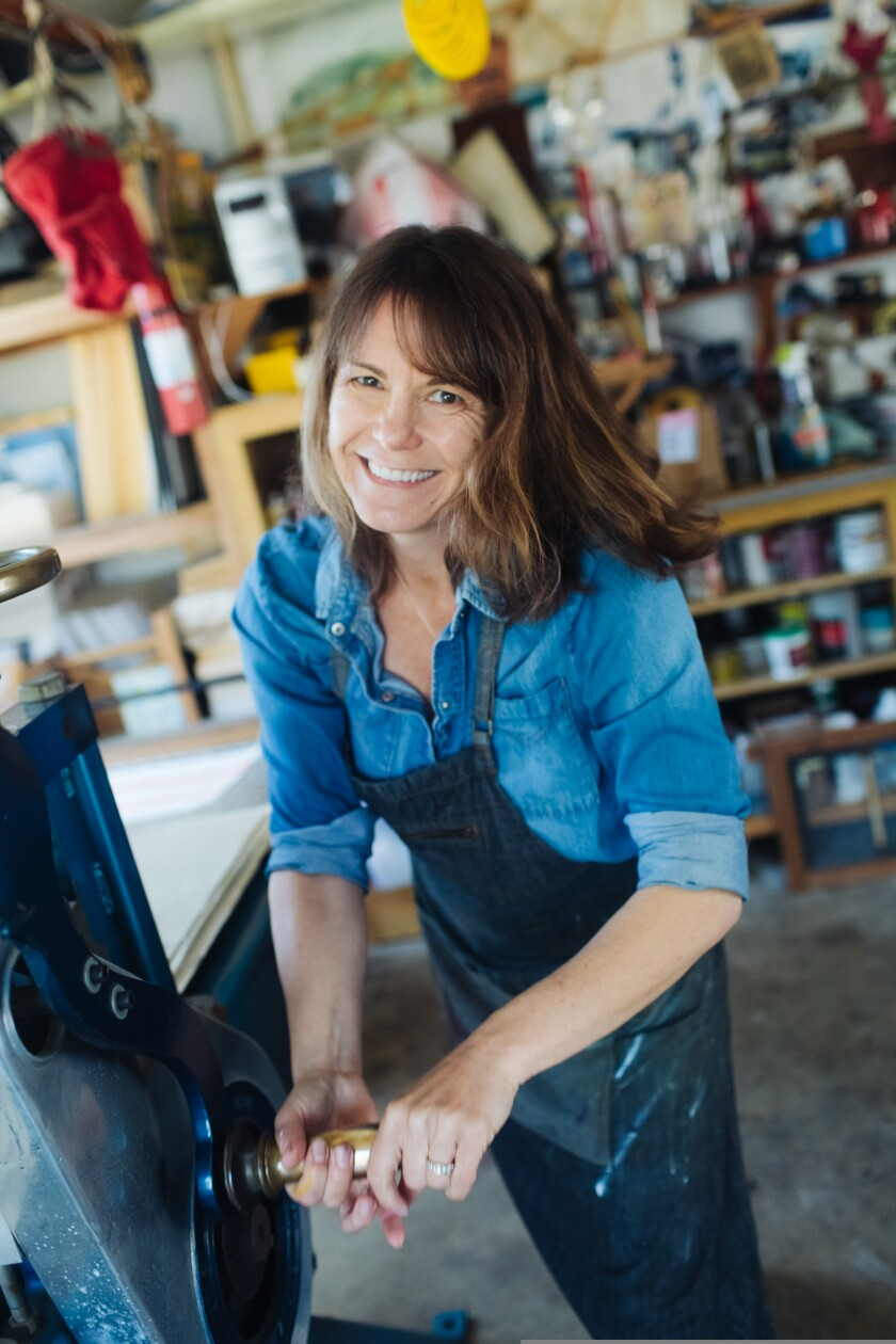 Stacy Frank, making a print
