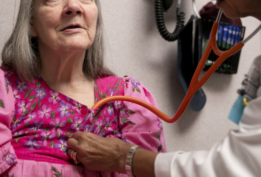 A nurse practitioner examines an elderly patient at a clinic in Guerneville in February 2020. Doctors fear a delay in preventative healthcare caused by the pandemic could lead to an influx in untreated health conditions. Photo by Anne Wernikoff for CalMatters