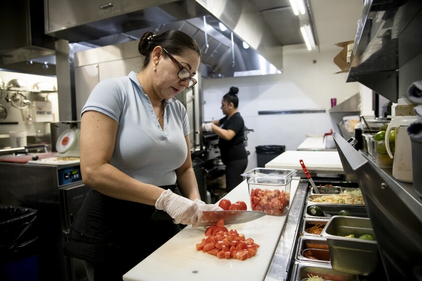 Cook Martha Garcia preps food in the kitchen at Verde Mexican Rotisserie in South Lake Tahoe on Oct. 6, 2021