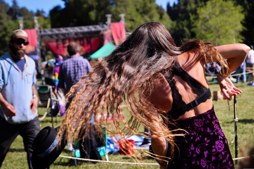 A fan swings to the sounds of Dark Star Orchestra Friday at Roaring Camp.