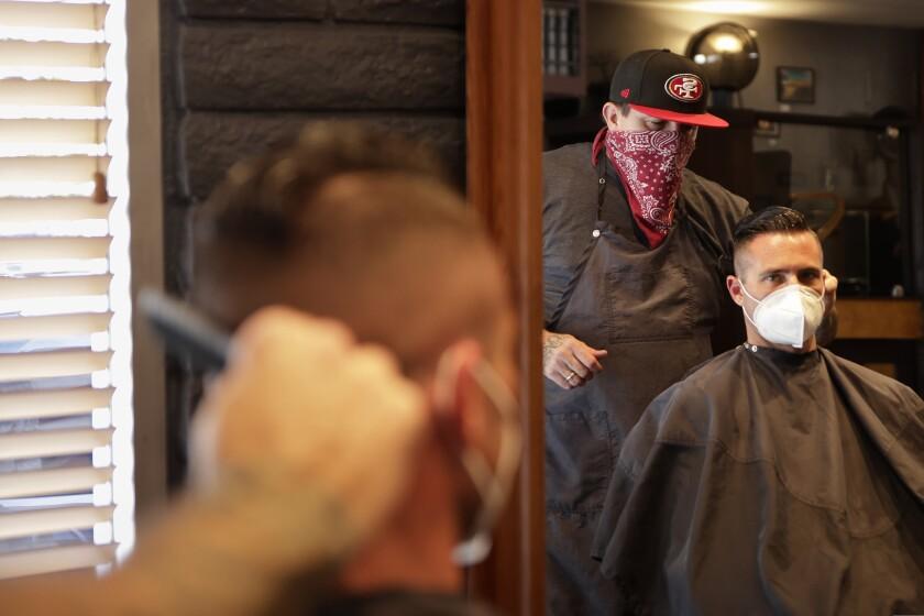 Man wearing mask gets haircut before Santa Cruz County stay-home order goes in effect