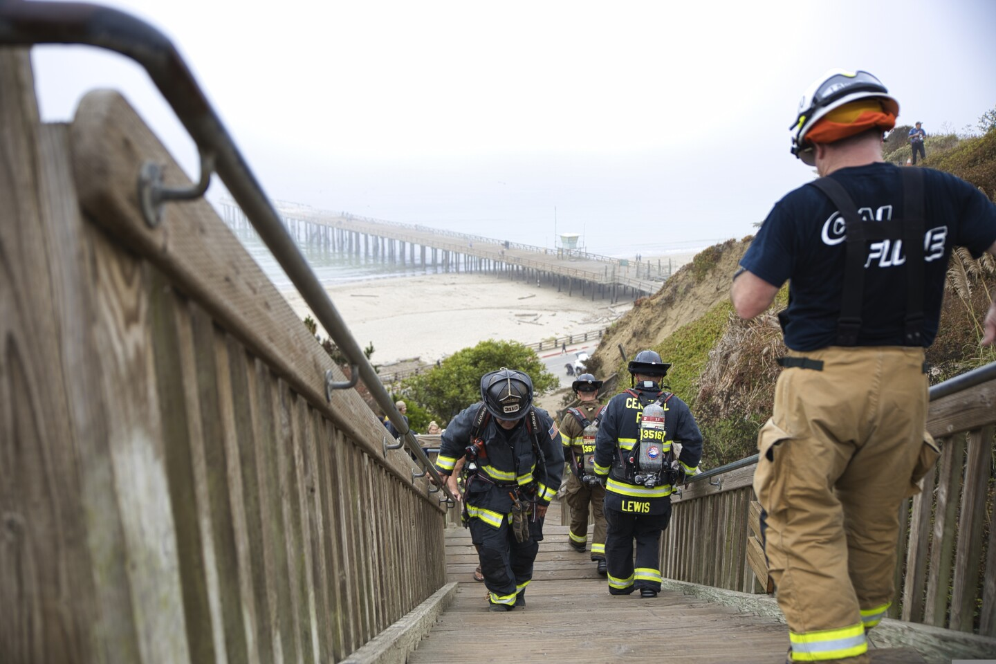 Firefighters walk up and down the Seacliff State Beach stairs as part of a 9/11 anniversary ceremony.