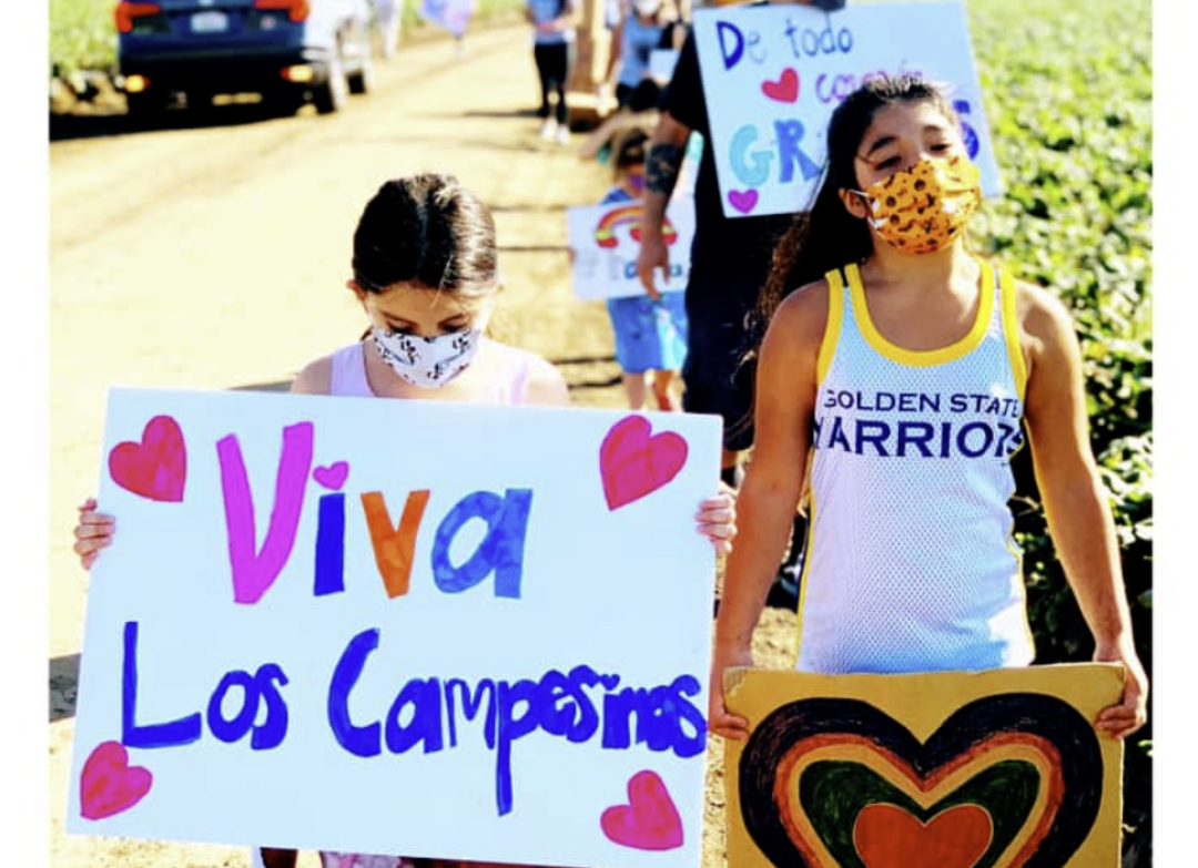 Maribel (right) marches this summer.