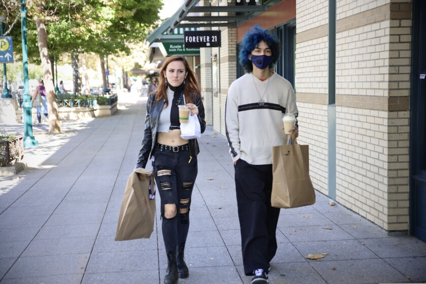 It was mask off, mask on Wednesday morning on Pacific Avenue in downtown Santa Cruz.