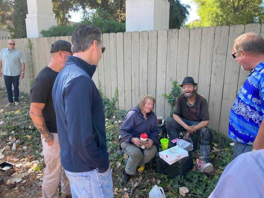 Gov. Gavin Newsom speaks to the homeless