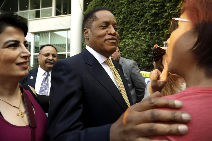 Conservative radio talk show host Larry Elder, who is running for governor of California, greets supporters