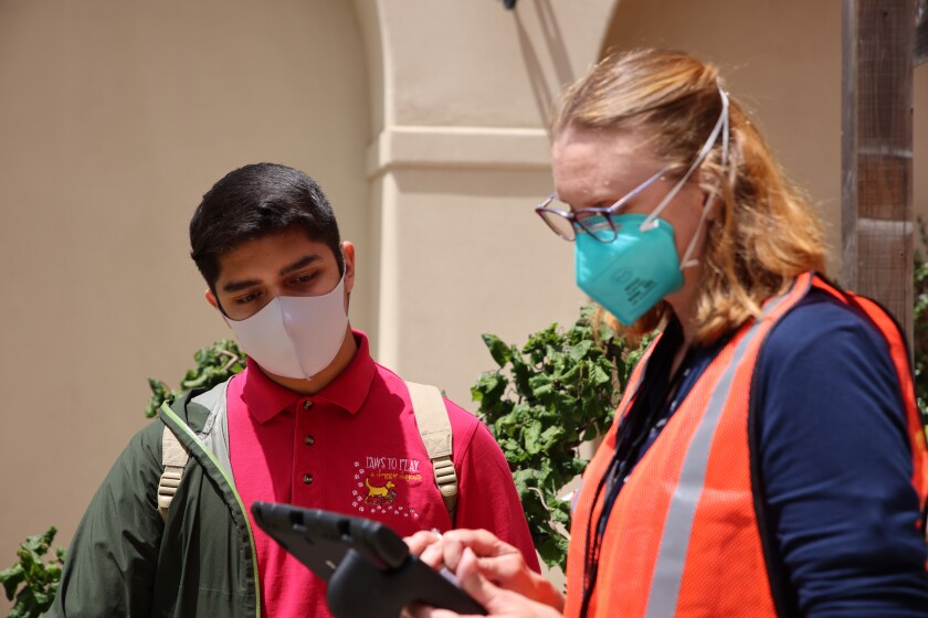 Ray Ortega, 25, speaks with a volunteer during a pop-up vaccination clinic at the MAH.