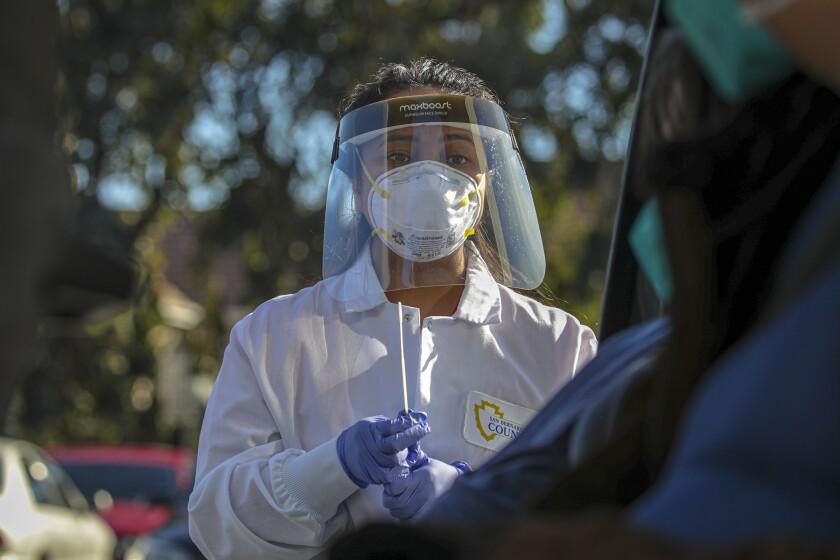 San Bernardino County Public nurse Marijorie Tabago collects nasal sample for COVID-19 testing