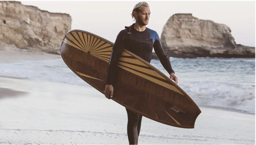 Surfer carries Ventana surfboard
