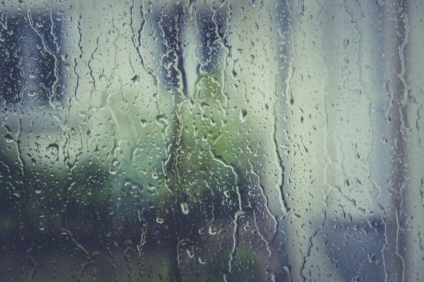 File image of rain dripping down window