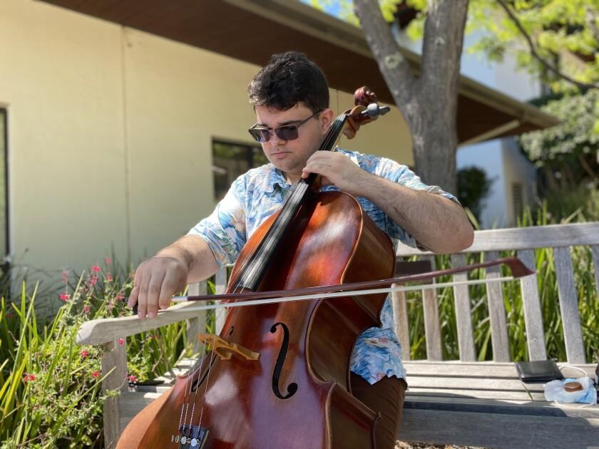 UCSC senior Ross Piscitello plays his cello.