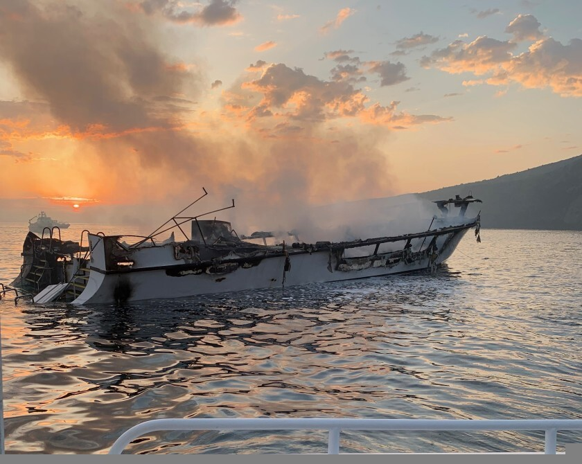 The dive boat Conception smolders after it burned off Santa Cruz Island on Sept. 2, 2019.