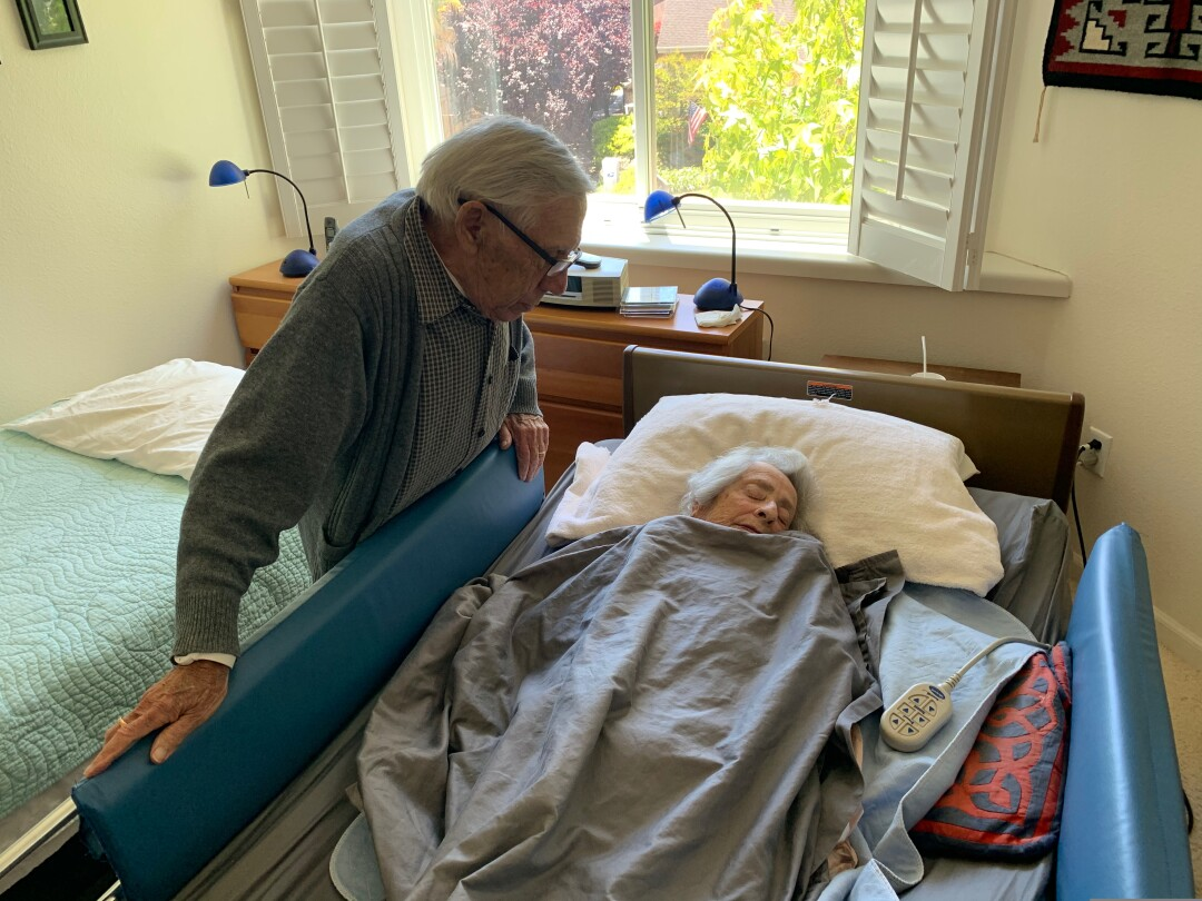 David Orzech looks over wife Judy in Hospice Care in June.
