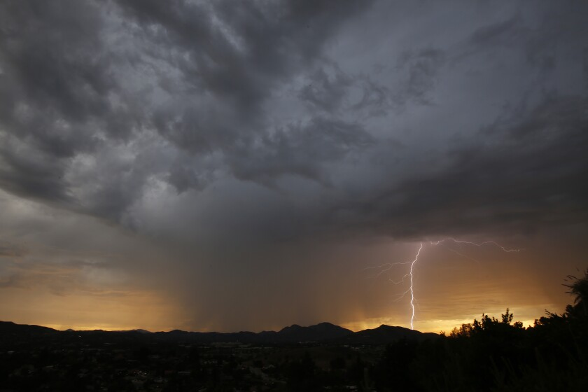 Lightning and some light rain are seen over the Oxnard plain northwest of Los Angeles on Monday.