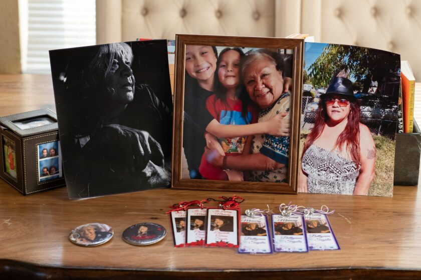 Photos of Elizabeth Sigala and Betty Ann Sigala who passed away from Covid-19 last year, in Leticia Aguilar's home in Elk Grove on Friday, February 26, 2021. Photo by Salgu Wissmath, USA TODAY