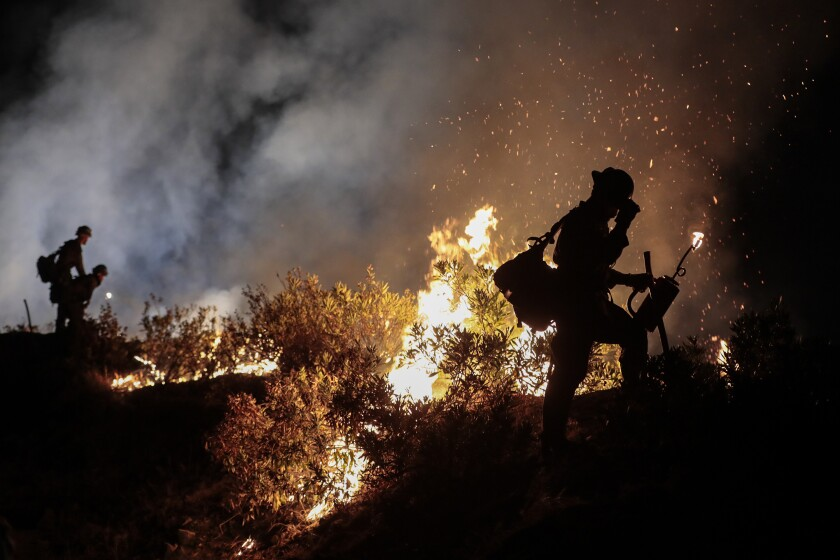 Blue Ridge Hot Shots crew members from Arizona join forces with California firefighters from Northern and Southern California