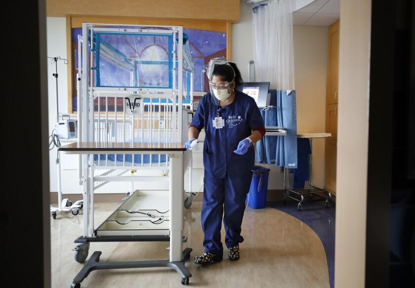 Environmental services attendant Rosalvina Baez cleans a room at Rady Children's Hospital