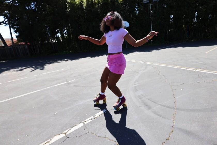 Elise Dauterive, 20, skates in a Santa Cruz parking lot.