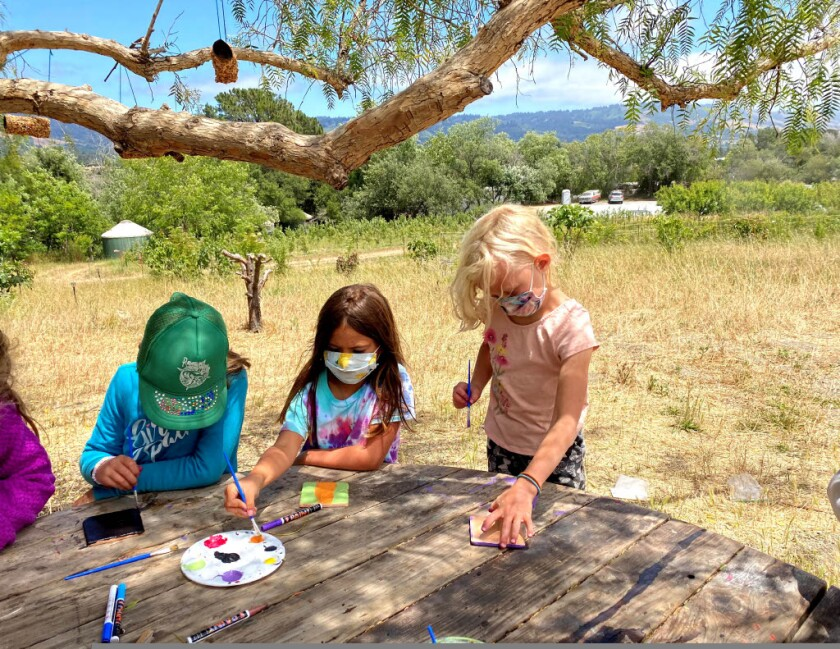 Kids painting at the farm