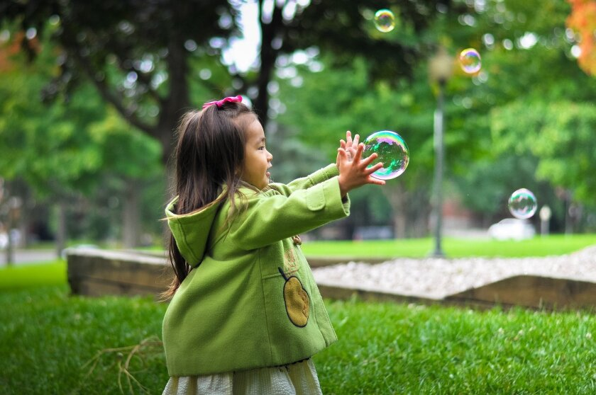 File image of toddler playing with bubbles