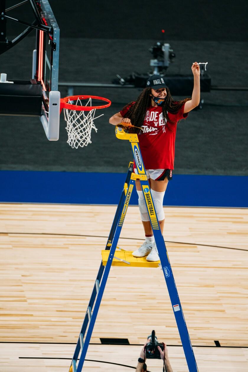 Haley Jones gets her piece of the victory net.