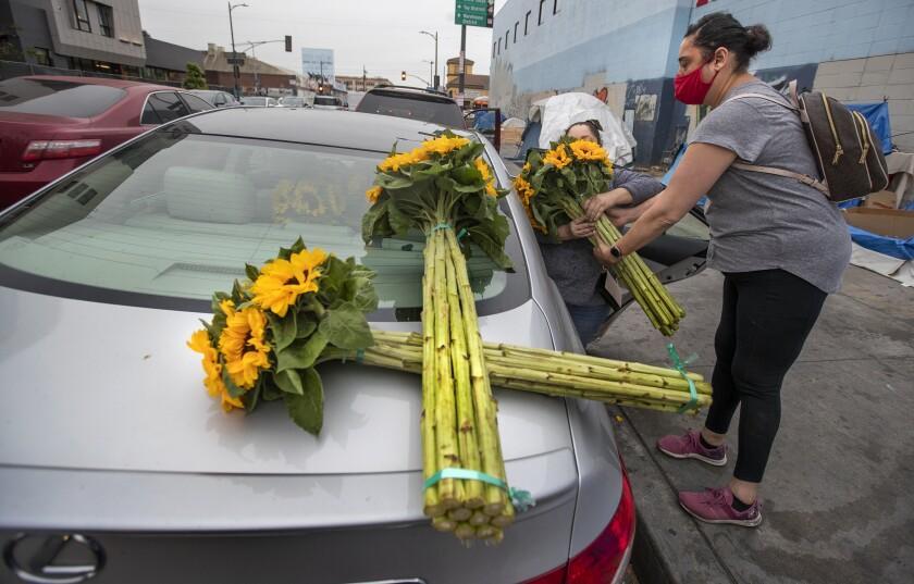 Women put flowers in car