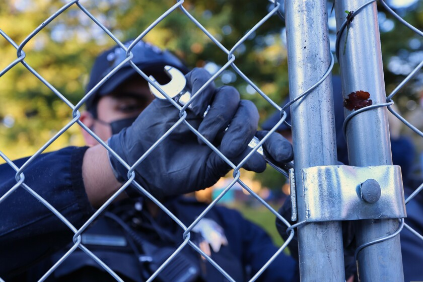 Police spent the morning breaking down chain-link fence.