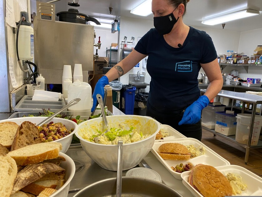 Chef Amanda Ganzer uses produce from the Homeless Garden Project to prepare a meal.