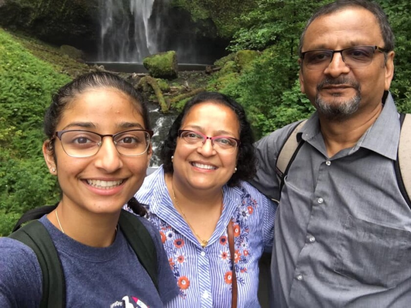 Garima Desai, left, poses for a photo with her parents at Multnomah Falls in Portland, Oregon.