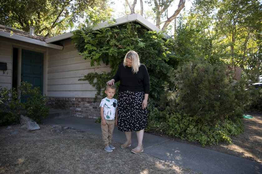 Elizabeth Olson and her son, Lucas, 2, in front of their newly-purchased home in the Land Park neighborhood of Sacramento