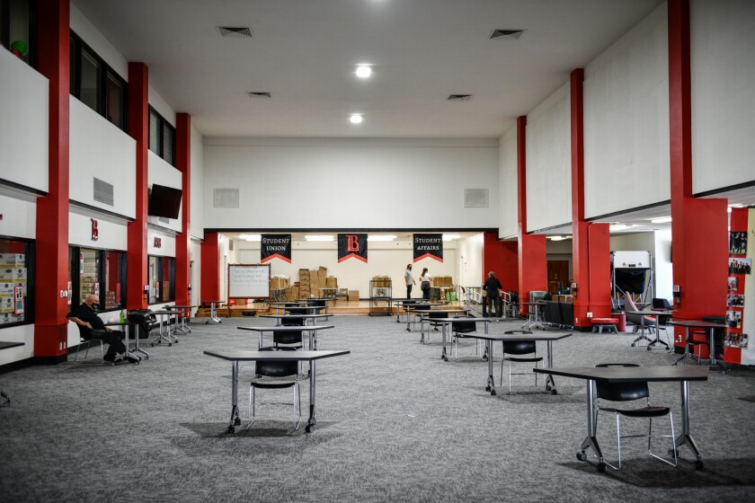 Tables are seperated for social distancing measures inside the student affair's building at Long Beach City College