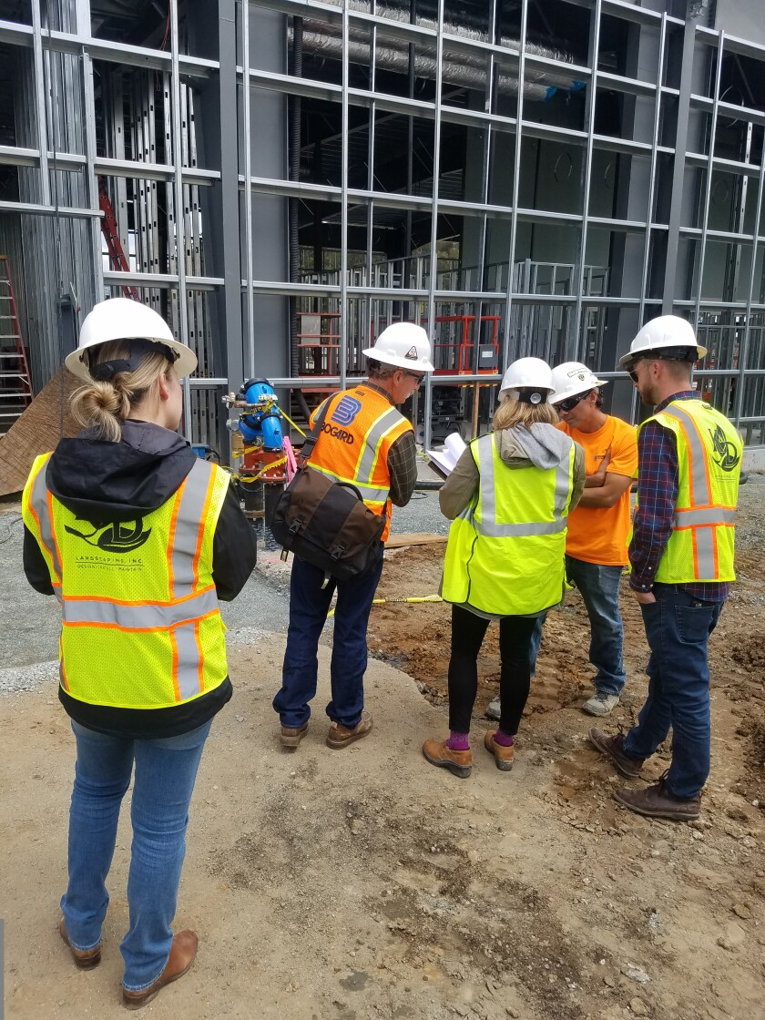 Pictured: Amy Andre at a job site. The women of K&D aren't afraid to get out in the field and get their hands dirty too!